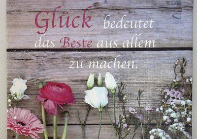 """Schild mit Spruch """"Glück bedeutet das beste aus allem zu machen"""""""